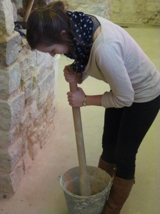 Lucie mixing mortar.