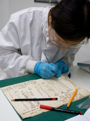 Yun prepares paper samples for analysis.
