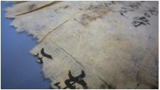 Image A: a close up of a handmade paper sample.