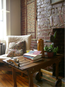 "A modern interior in New York, proudly exhibiting exposed brick walls as an architectural feature. ""My apartment"" by ""Michelle Spaulding""; no modifications made. Licensed under CC-BY2.0. Accessed 19 June 2013. https://www.flickr.com/photos/reconstructionist/2877943728/"