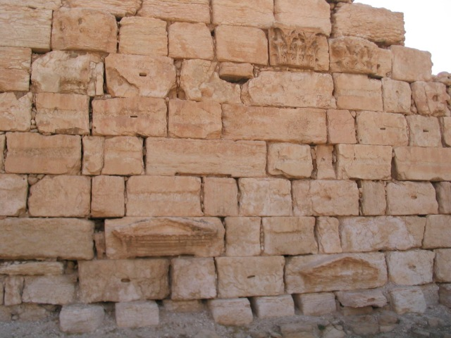 A wall in the Temple of Bel constructed from Roman remains.