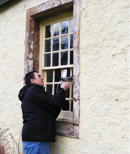 Portable X-ray fluorescence being used to characterise historic window glass, Traquair House, Peebles, Scotland.